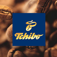 Tchibo logo with a coffee bean background