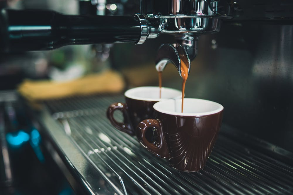 coffee pouring into a mug out of a machein