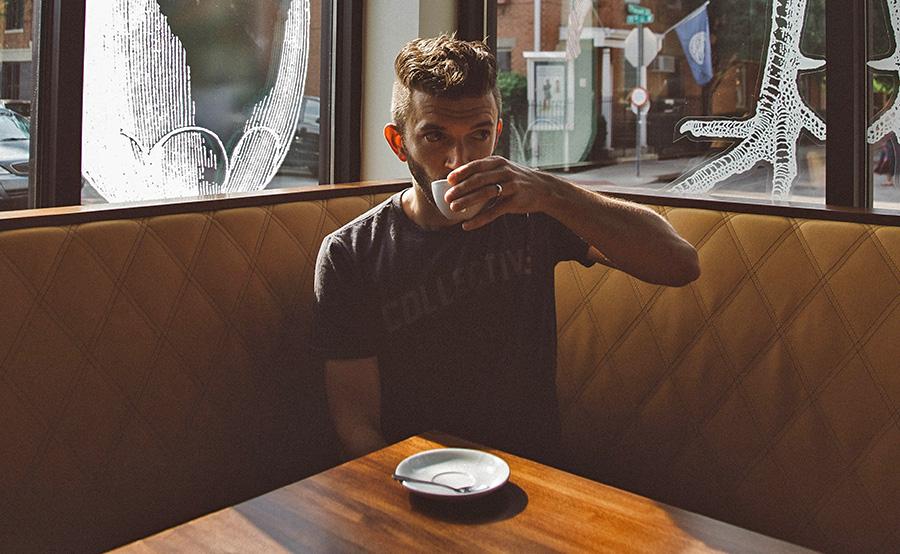 man drinking coffee in pub